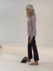 Lora doing traditional barefoot calf stretch for restless legs syndrome relief