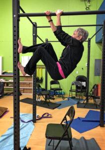 Joan climbing hanging cage
