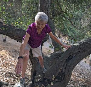 Joan climbing tree
